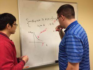 PhD students Quinn Morris and Byungjae Son